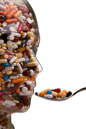 Many different tablets and medicines in a Bowl