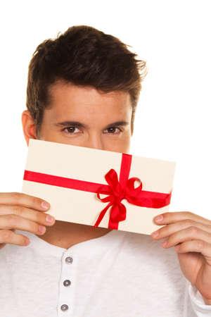 Man holding a gift voucher in his hand. Shopping voucher.