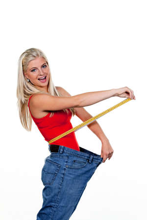 Young woman after a successful diet with great pants: