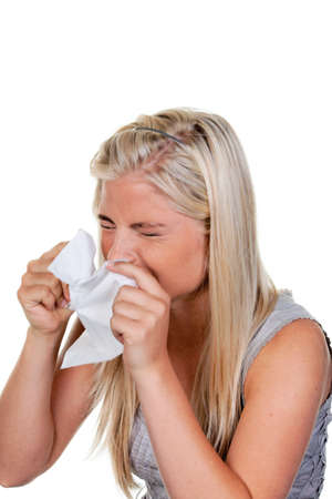 Woman with allergies, hay fever and handkerchief