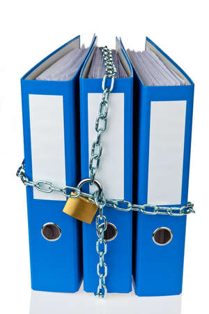 A file folder with chain and padlock closed. Privacy and data security.