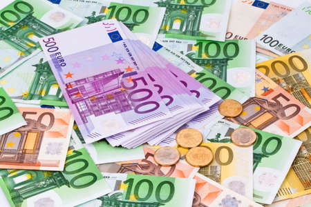 Many Euro banknotes of the European Union next to each other.
