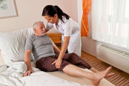 Photo pour a nurse in aged care for the elderly in nursing homes - image libre de droit