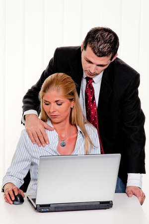 Photo pour Sexual harassment of women at work in the office - image libre de droit