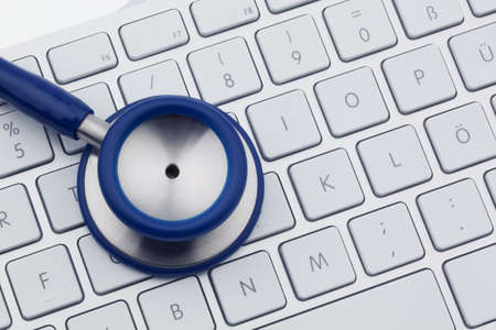 Photo pour A stethoscope is on the keyboard of a computer - image libre de droit