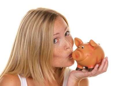 A young woman saves money and coins for the future. Pension and savings.