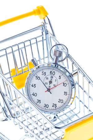 A stopwatch is in a shopping cart icon image for opening times and working hours in retail.