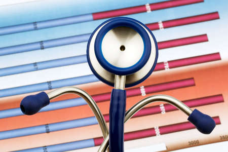 a stethoscope and a list of numbers. costs of health and medicine