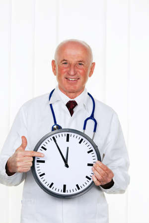 a doctor holding a clock. on the ziffernbaltt it is 11:55