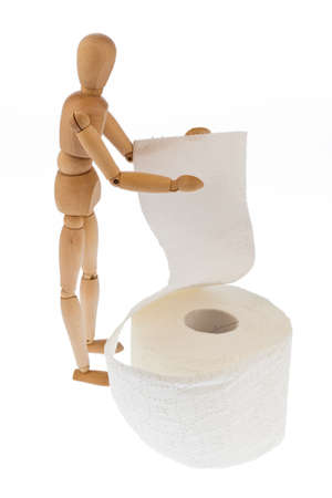 a wooden figure and a roll of toilet paper.