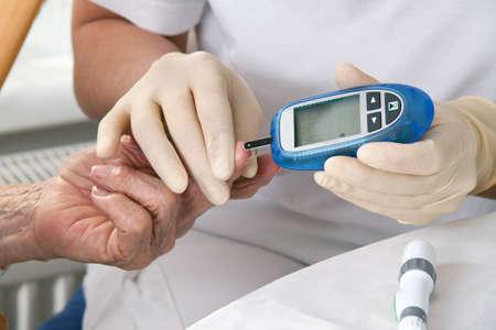 blood glucose meter. the blood sugar value is measured on a finger