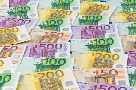 many euro banknotes of the european union. photo symbol for wealth