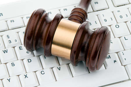 gavel and keyboard. legal certainty on the internet. webauktionen.