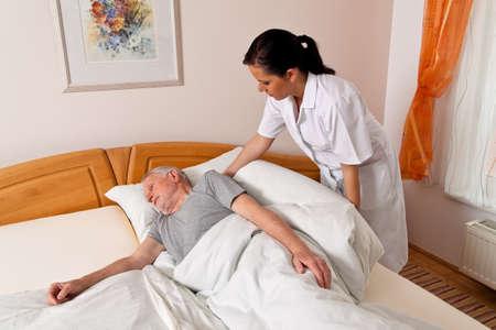 Photo pour a nurse in elderly care for the elderly in nursing homes - image libre de droit