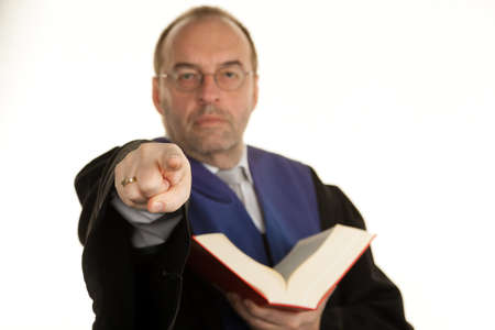 a judge with a law book in court. book in hand.
