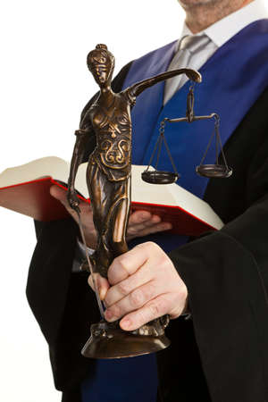 a judge with a law book in court  with justice figure in the hand