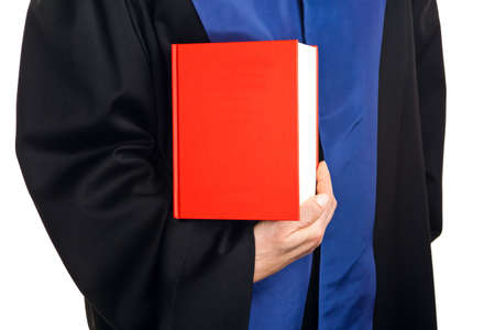 a judge with a law book in court  gavel in hand
