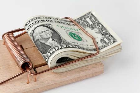 many american dollar bills in mouse trap  debt trap