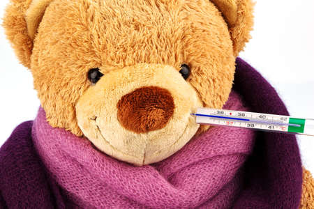 a plush bear with a thermometer in your mouth  representative photo of chills, fever and flu