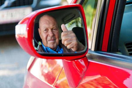 elderly man in a seat belt in a car