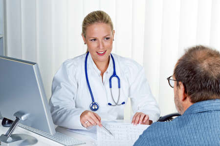 a young doctor with stethoscope in her doctor s office  in an interview with a patient