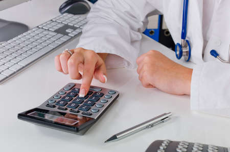 a doctor in the surgery performs administrative work  costs in the doctor s office