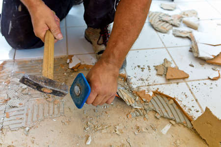Photo pour broken tiles in the renovation of a bathroom  remodeling and renovation in the living area  tiler at work - image libre de droit