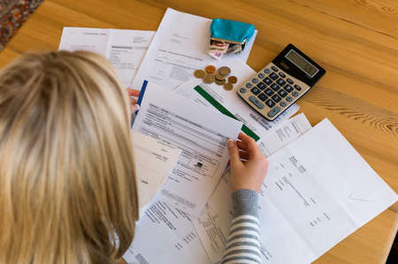 a woman with unpaid bills has many debts  unemployment and personal bankruptcy