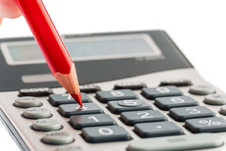 a red pen on a calculator  save on costs, expenditures and budget for bad economy