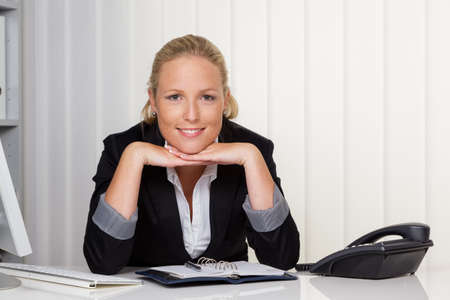a young successful woman sitting at her desk in the office
