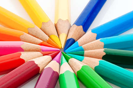 many different colored pencils on a white background