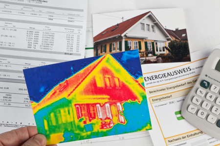 saving energy through insulation  house with thermal imaging camera photographed