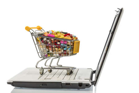 shopping cart with tablets and computers  photo icon for the purchase of drugs on the internet