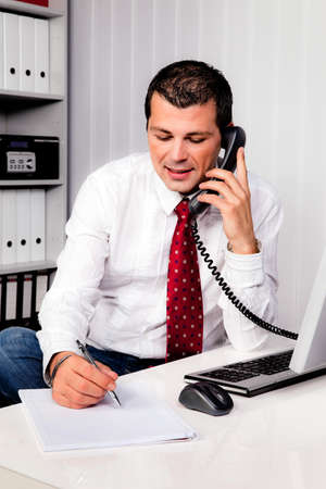 young businessman in office with telephone