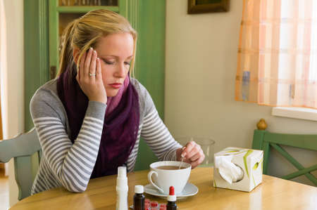 woman on sick leave with tea and medicines  cold, cold and flu season