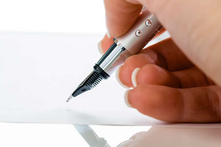 a hand with a pen