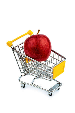 an apple is in a shopping cart. photo icon for the purchase of healthy, vitamin-rich foods.