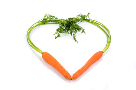 a heart made from organically grown carrots. fresh fruit and vegetables are always healthy. symbolic photo for healthy nutrition.
