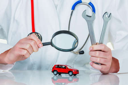 a model of a car is examined by a doctor