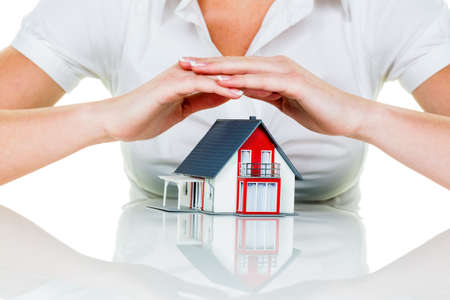 Photo pour a woman protects your house and home. good insurance and reputable financing calm. - image libre de droit