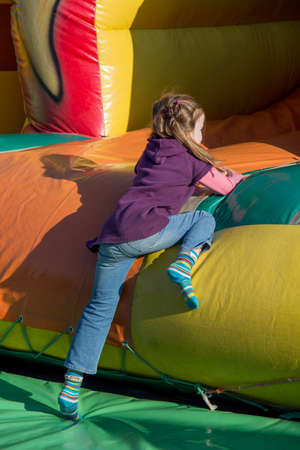 on a folk festival have children much fun in a bouncy castle.