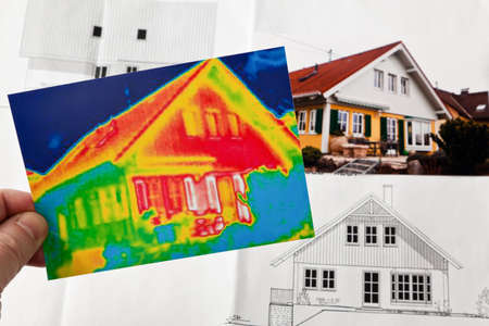 saving energy through thermal insulation. house with thermal imaging camera photographed.