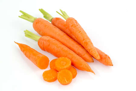organically grown carrots lying on white background. fresh fruit and vegetables are always healthy.