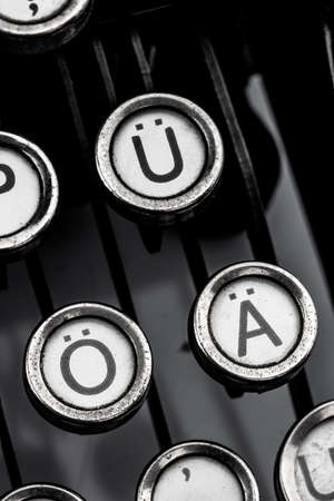 german umlauts on an old typewriter. symbolic photo for communication in former times