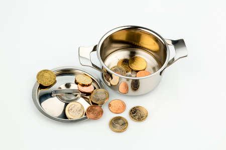 a pot with a few euro coins symbol photo for sovereign debt and financial crisis