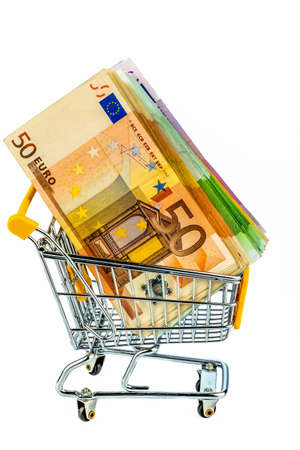 euro banknotes in a shopping cart, photo icon for purchasing power, shopping, money printing and inflation