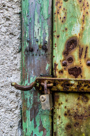 rusted lock a door, a symbol of decay, damage, perishability