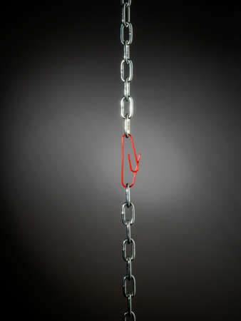 a chain is held together with a b?rokklammer. symbol photo for security, trust and teamwork