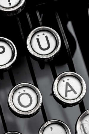 german umlauts on an old typewriter. symbol photo for communication in earlier times