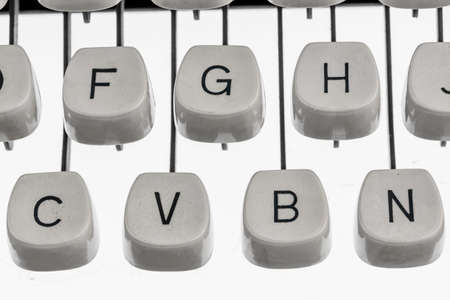 keyboard and letters of an old typewriter. symbol photo for communication in earlier times